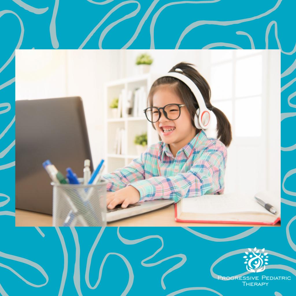 Child sitting at computer.