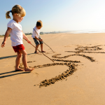 Children writing in the sand