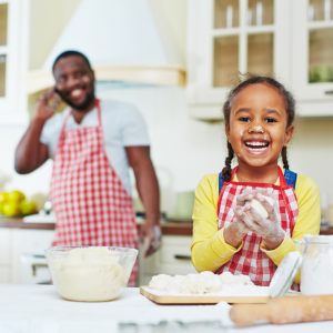 Child cooking with father
