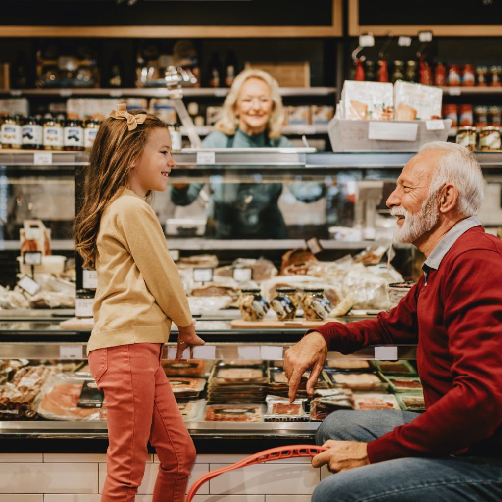 Child grocery shopping with grandparent