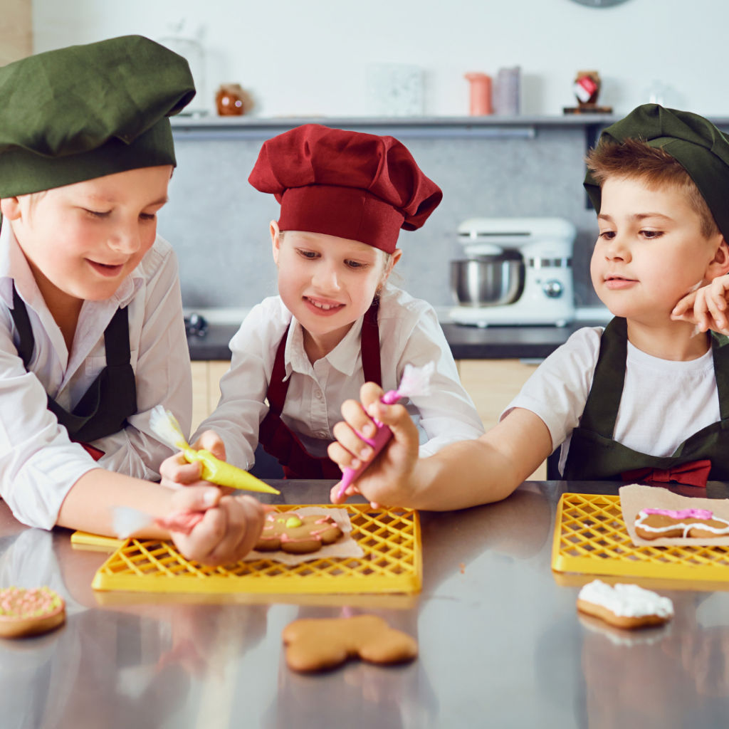 Children decorating cookies.