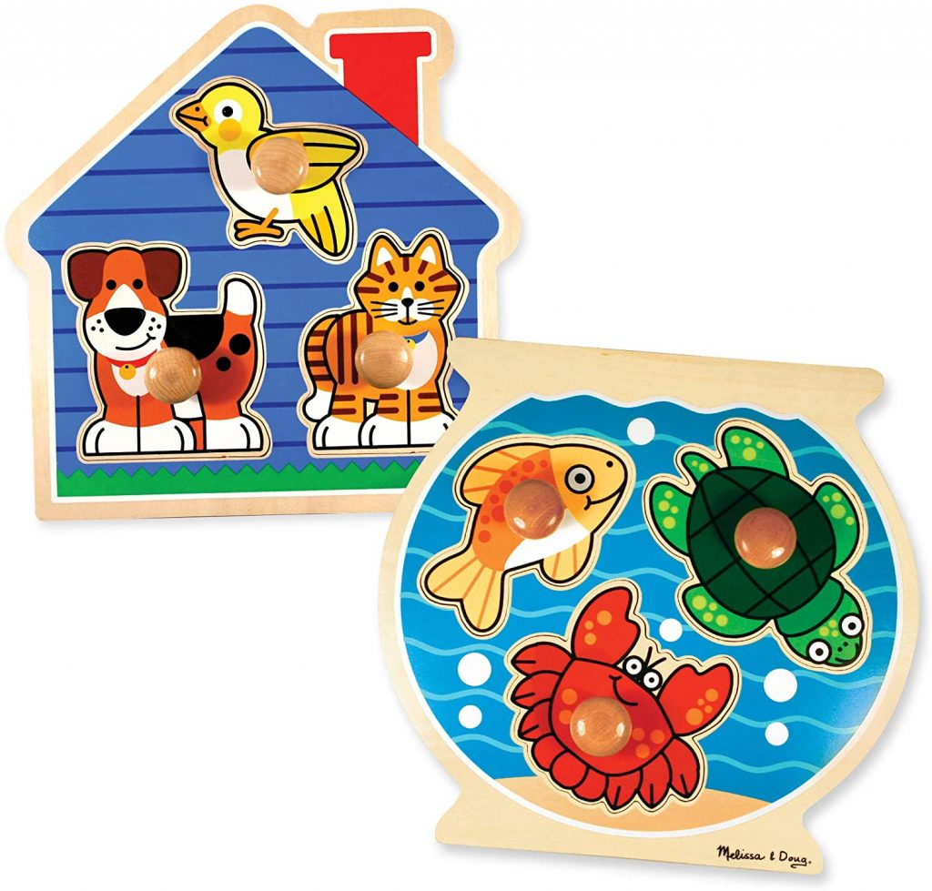 Picture of 2 large knob puzzle with duck, dog and cat in one and fish, turtle and crab in the other.