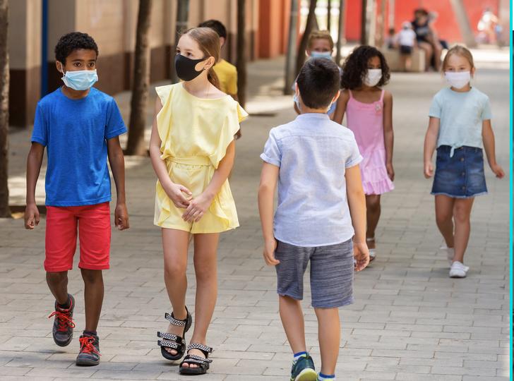 School aged children walking around with masks on.