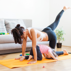 Toddler imitating parent during Yoga